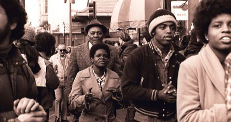 Members of Peoples Temple including Richard Parr, Wesley Johnson, Barbara Hickson, Ricky Johnson and Sandra Cobb attend an anti-eviction rally at the International Hotel, 848 Kearny Street in San Francisco, January 1977. Photo by Nancy Wong CC BY-SA 4.0