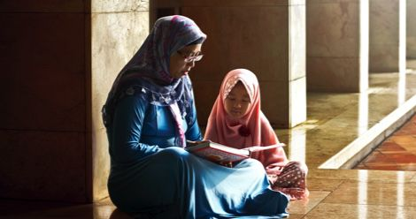 muslim mother reading to daughter children's book feature