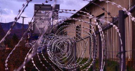 prison barbed wire dystopia feature