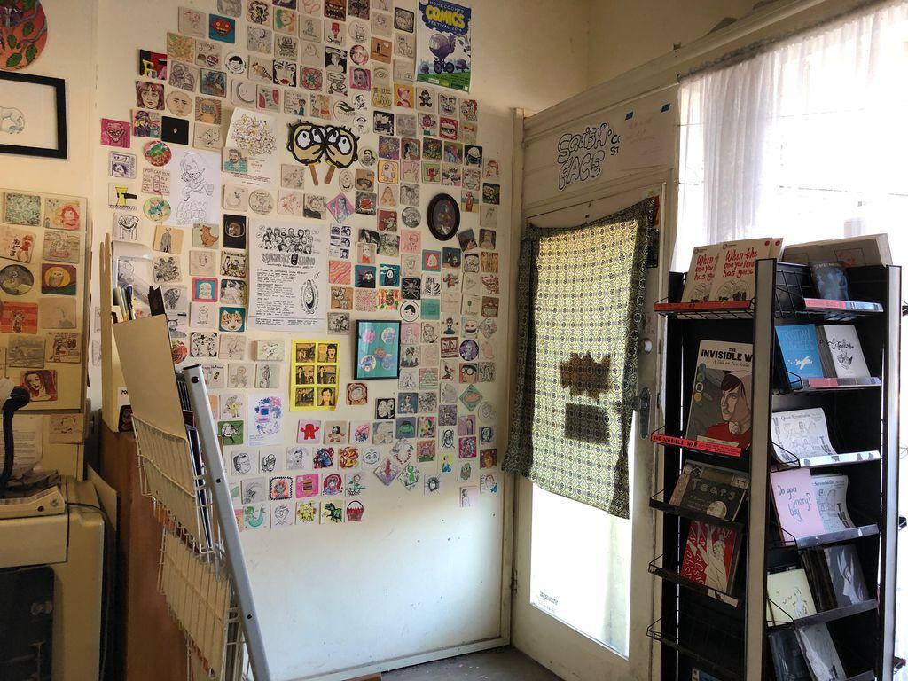 Display racks and wall of illustrations