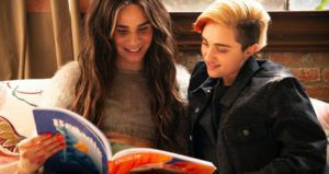 trans couple reading colorful book queer lgbtq feature