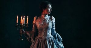 victorian woman holding candelabra historical fiction mystery thriller and crime feature