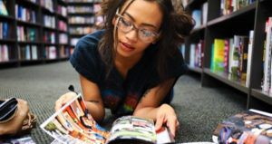 young woman or teen reading comics graphic novels feature