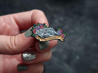 Floral Millennium Falcon enamel pin with the text 'Fly Casual'