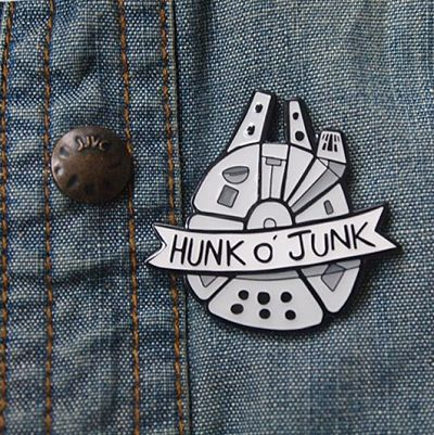 Millennium Falcon enamel pin with the text 'Hunk O' Junk'