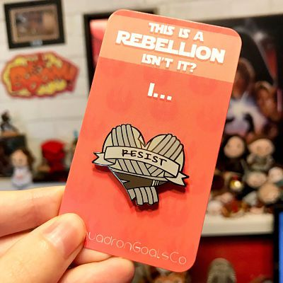 Rey of Jakku enamel pin with the text 'Resist'