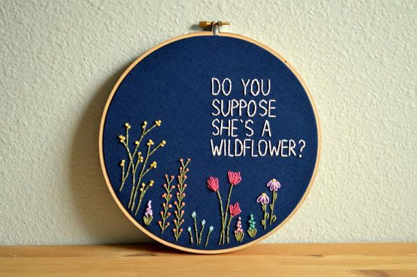 do_you_suppose_shes_a_wildflower_embroidery_art_with_embroidered_flowers_growing_at_the_bottom