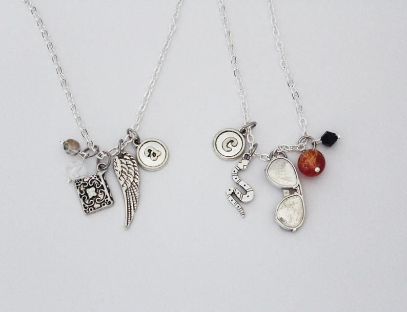 Good Omens gifts-Book Riot-Crowley and Aziraphale necklace set
