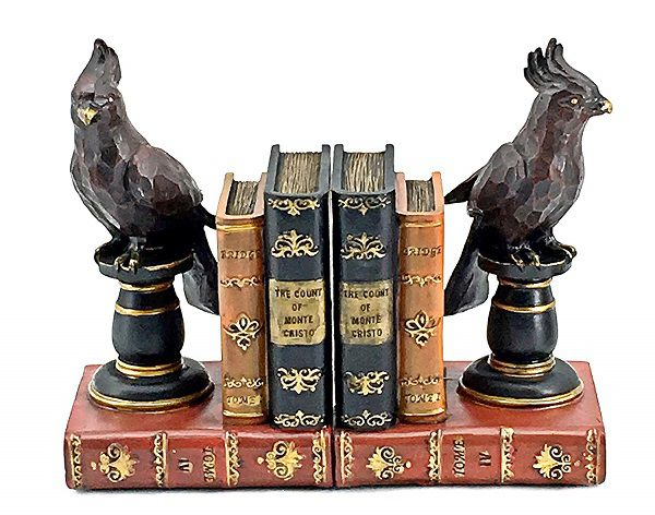 Birds on pedestals on books bookends