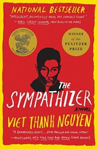cover of The Sympathizer by Viet Thanh Nguyen, a red cover with a yellow border and a black ink illustration of a man's head and shoulders in the middle