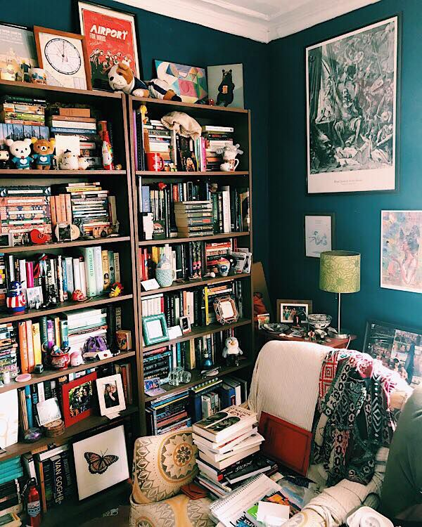 A bookshelf piled with books