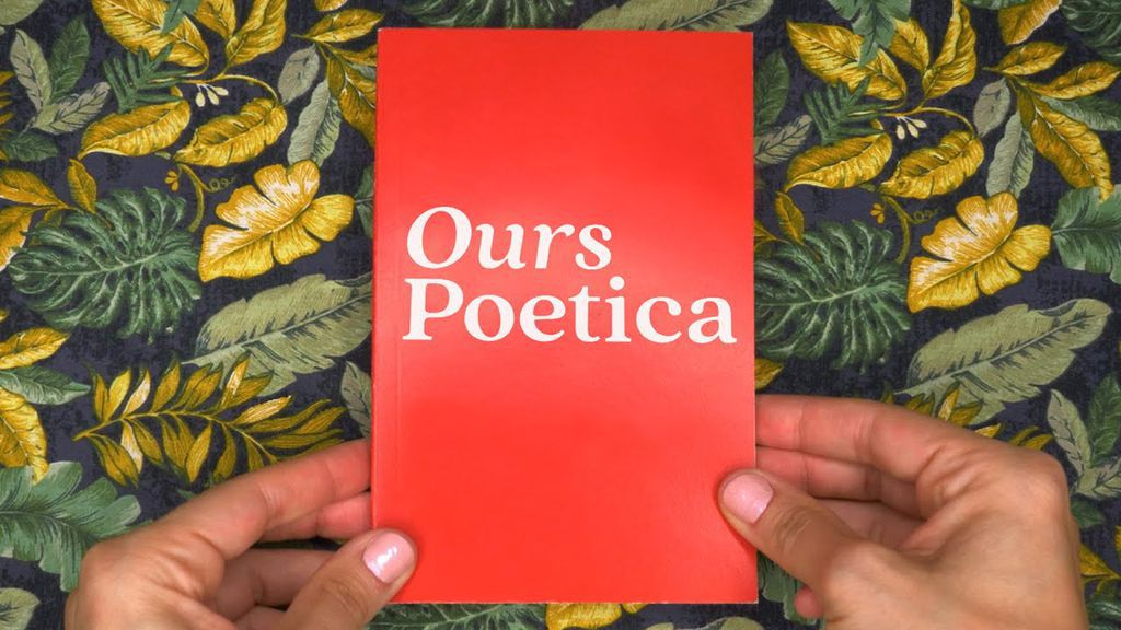 Hands holding a book titled Ours Poetica