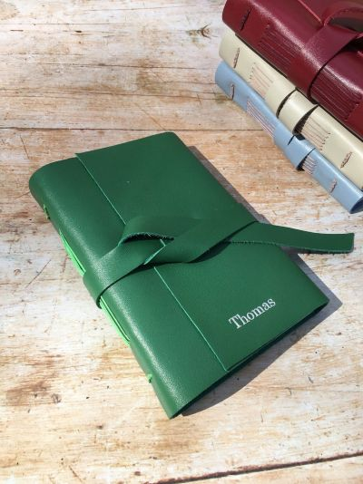 green leather journal cover with tie
