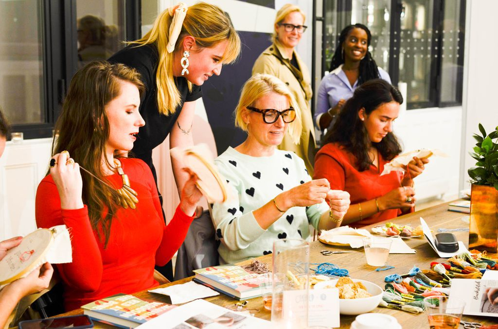 Elizabeth Gilbert cross-stitching at CRAFTED x Riverhead's Sip & Stitch event