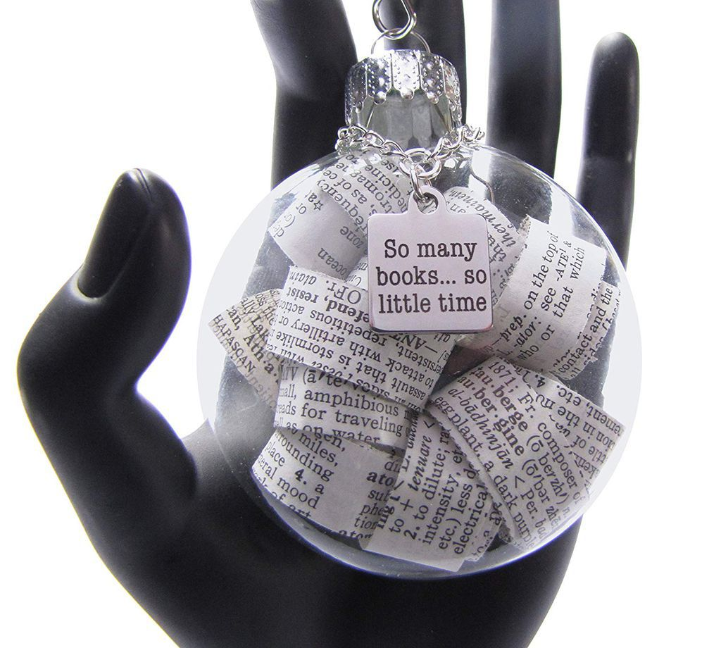 puffed glass disk ornament filled with curled dictionary page strips
