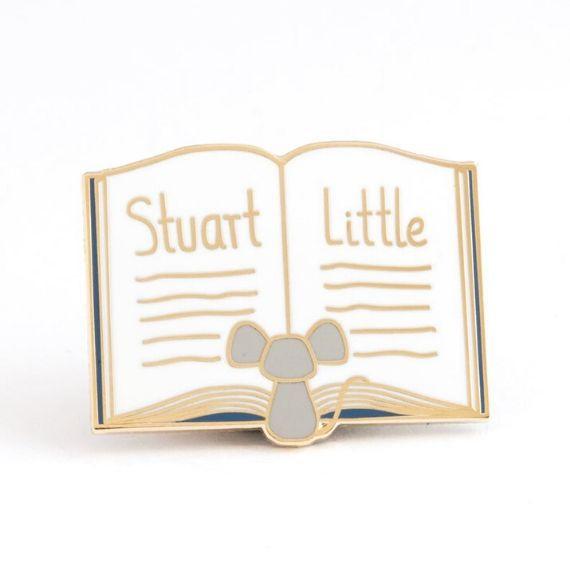 Enamel pin featuring mouse reading Stuart Little