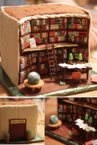 An elaborately decorated cake made to look like a library, which includes books, a ladder, a desk, and decorations.