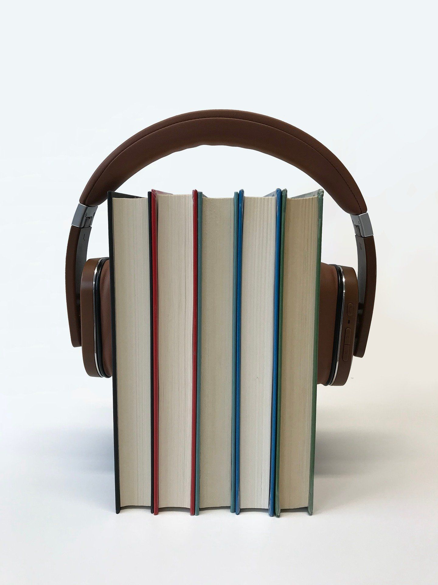 Books with a pair of headphones on them