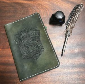 leather notebook portfolio with Slytherin crest