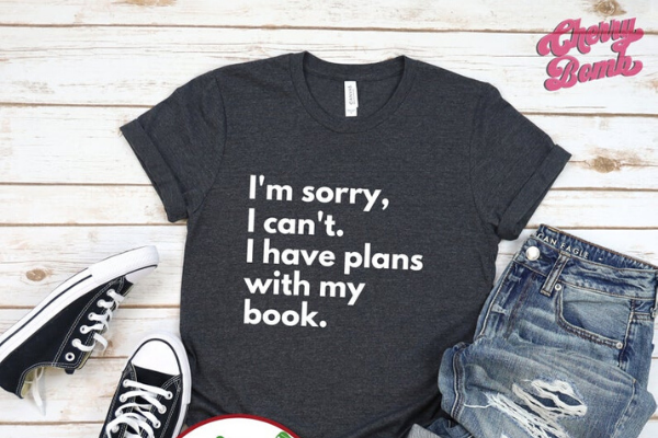 Plans With My Book Shirt from Etsy Finds for Bookish Introverts | bookriot.com