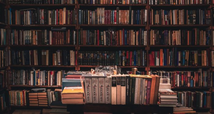 photo of a bookstore with a table full of book stacks