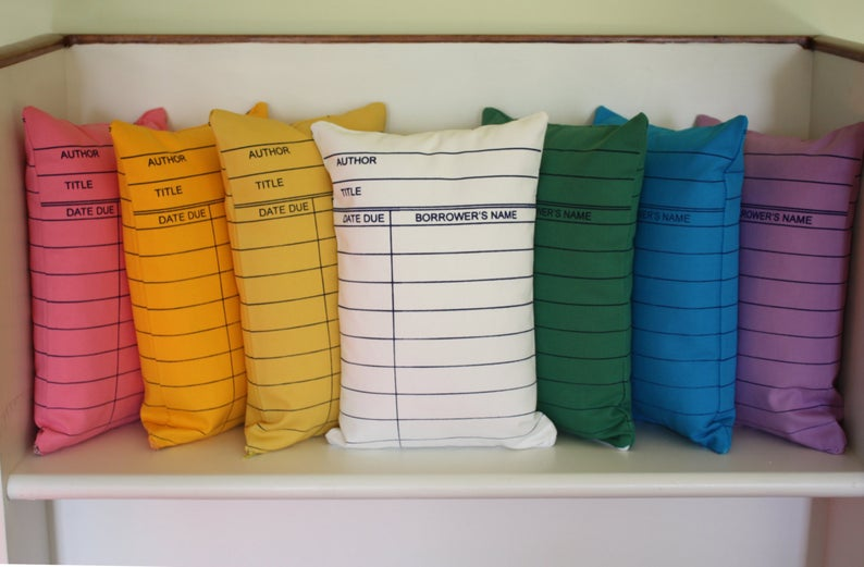 Brightly colored library card pillows