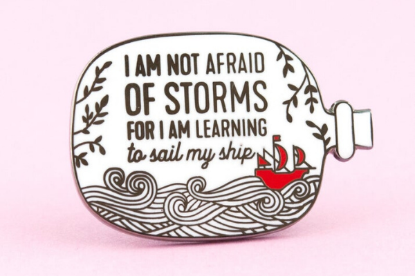 Not Afraid of Storm Enamel Pin from All The LITTLE WOMEN Etsy Finds | bookriot.com