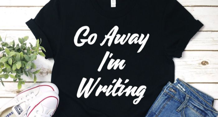 a navy blue t-shirt with text that reads: Go Away I'm Writing