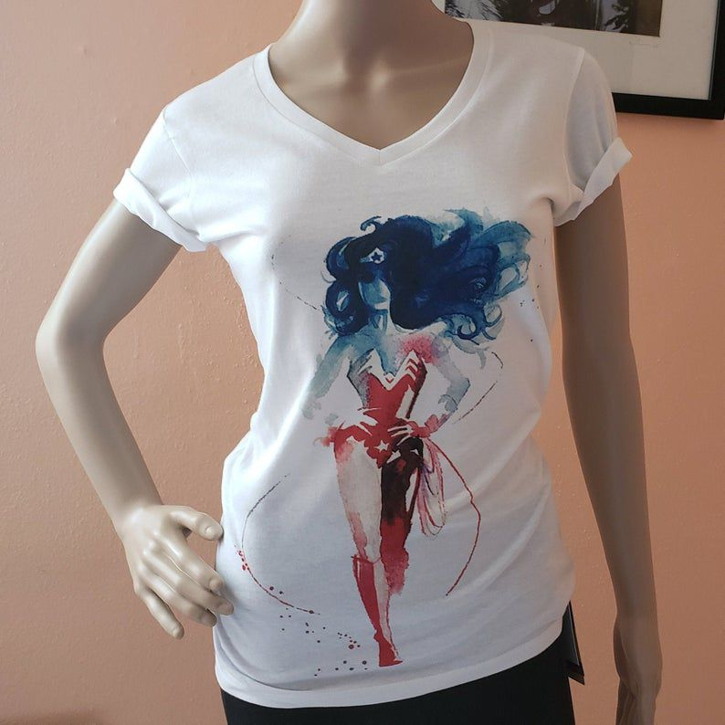 http://www.awin1.com/cread.php?awinmid=6220&awinaffid=258769&clickref=&p=https://www.etsy.com/listing/734146807/wonder-woman-shirt-dc-comic-superhero-v