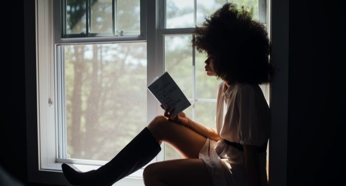 black woman reading a book feature 700x375 1.jpg.optimal