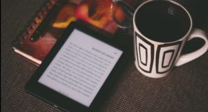 image of an reader and coffee mug