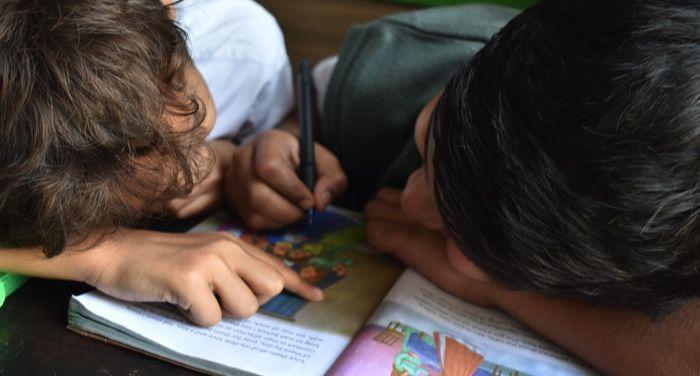 kids writing in workbook