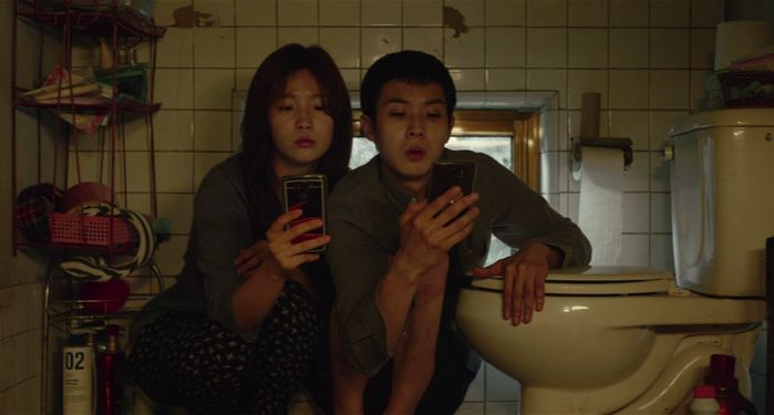 Woo-sik Choi and So-dam Park in still frame from Parasite film