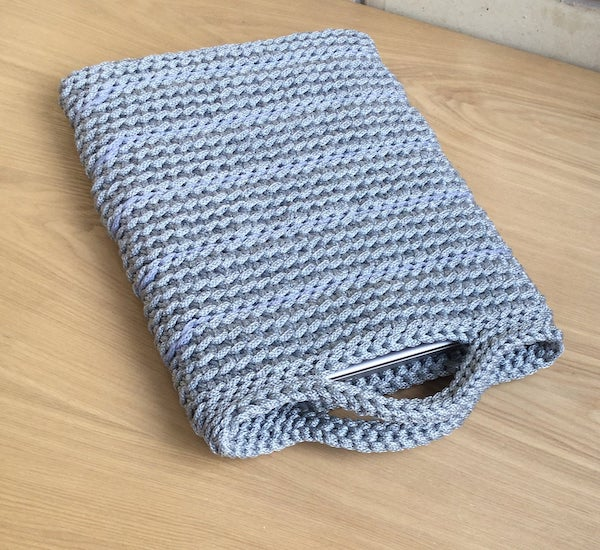 neutral grey crochet book sleeve with handles