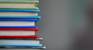 spines of a stack of books https://unsplash.com/photos/lUaaKCUANVI