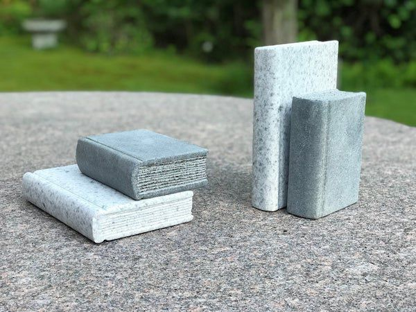 Hand-carved granite books. Image from Etsy shop.