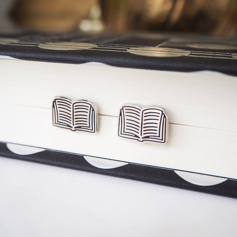 http://www.awin1.com/cread.php?awinmid=6220&awinaffid=258769&clickref=&p=https://www.etsy.com/listing/699748963/book-stud-earrings-silver-book-earrings?ga_order=most_relevant&ga_search_type=all&ga_view_type=gallery&ga_search_query=book+jewelry&ref=sr_gallery-1-26&organic_search_click=1&cns=1