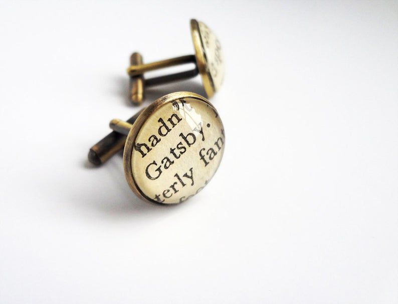 http://www.awin1.com/cread.php?awinmid=6220&awinaffid=258769&clickref=&p=https://www.etsy.com/listing/96154150/great-gatsby-cufflinks-graduation?ga_order=most_relevant&ga_search_type=all&ga_view_type=gallery&ga_search_query=book+jewelry&ref=sc_gallery-2-19&plkey=5cd3c7181a2b9960dde8da2478da732a7d068c1e%253A96154150&pro=1