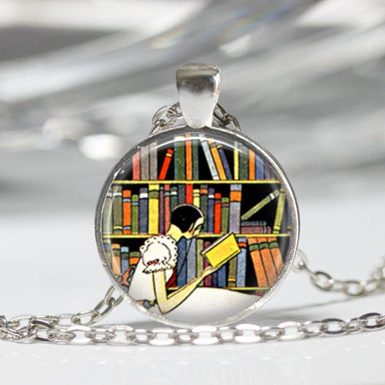 http://www.awin1.com/cread.php?awinmid=6220&awinaffid=258769&clickref=&p=https://www.etsy.com/listing/203739311/librarian-necklace-book-jewelry-reading?ga_order=most_relevant&ga_search_type=all&ga_view_type=gallery&ga_search_query=book+jewelry&ref=sr_gallery-1-30&organic_search_click=1