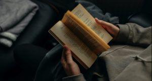 hands holding an open book https://unsplash.com/photos/iyKVGRu79G4