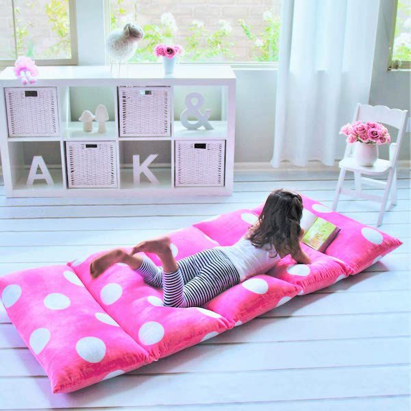 Image of child on pillow bed; promotional image from Amazon https://www.amazon.com/Butterfly-Craze-Recliner-Alternative-Included/dp/B01IFZ6AS2/ref=redir_mobile_desktop?ie=UTF8&aaxitk=DmnIhdegSUJaTZV3aIwIGA&hsa_cr_id=9397621040201&ref_=sbx_be_s_sparkle_td_asin_1