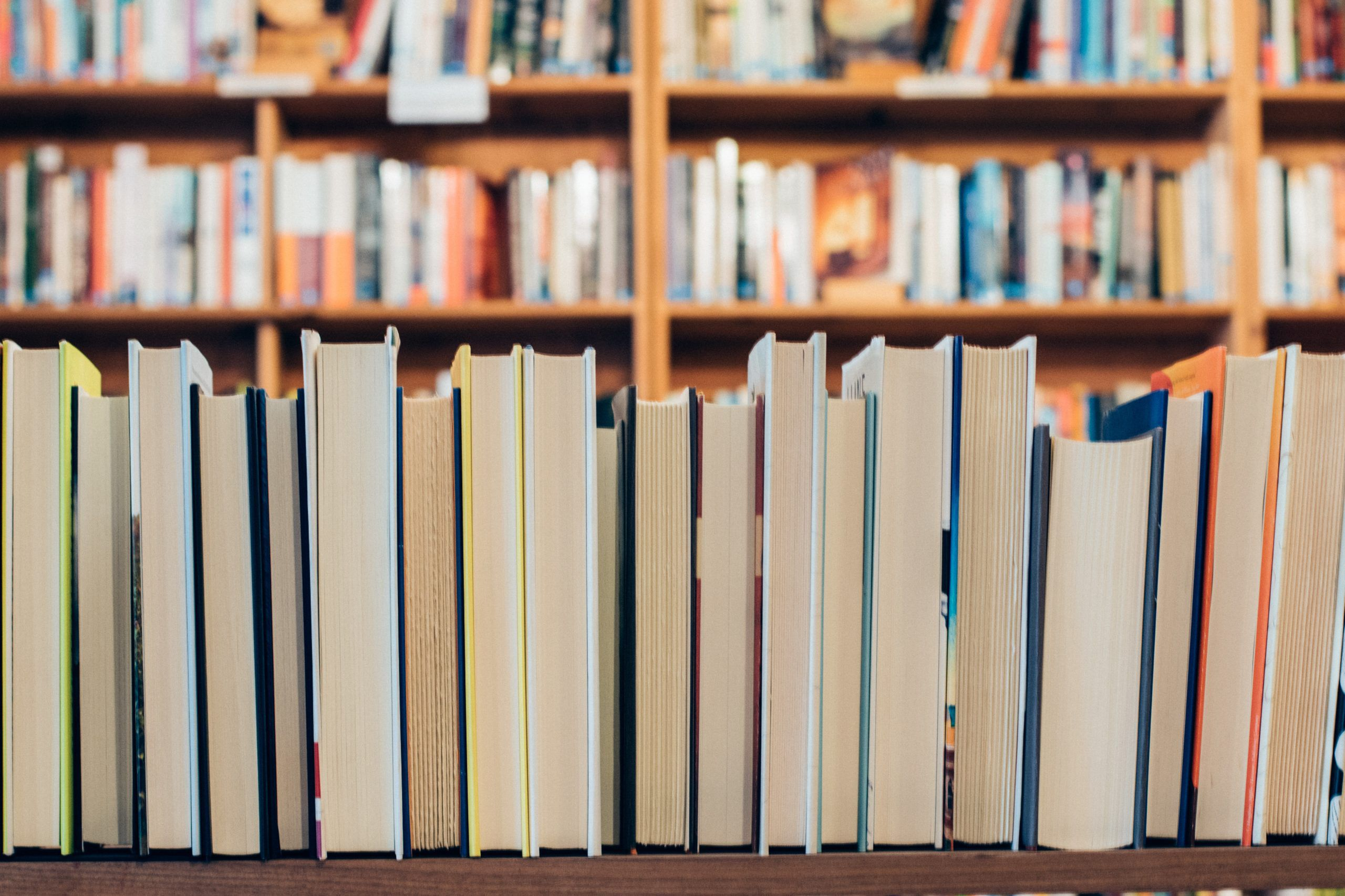 a shelf of books viewed spines facing away