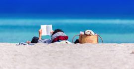 person reading at the beach