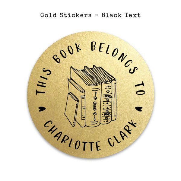 """Gold circle sticker with image of books in the middle and """"this book belongs to"""" on the outer edges"""