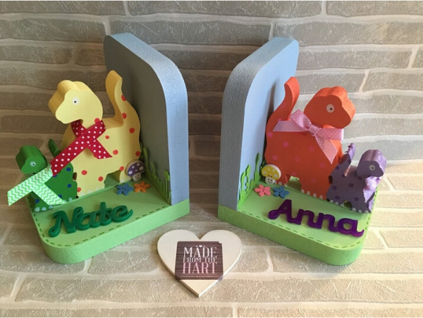 colorful wooden dinosaur bookends