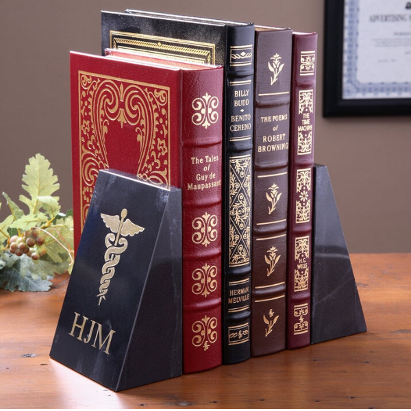 marble bookends with caduceus icon