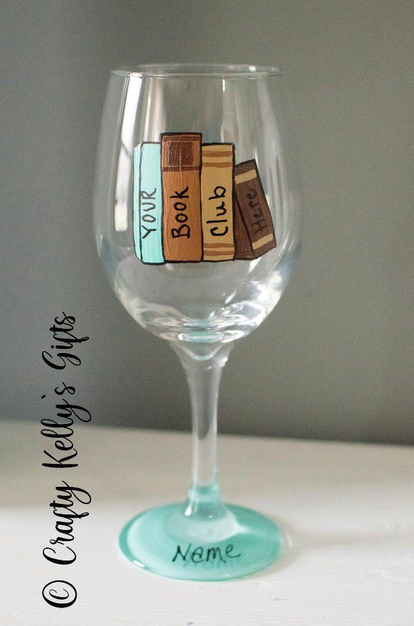"""Wine glass with painted book spines reading """"your book club here"""""""