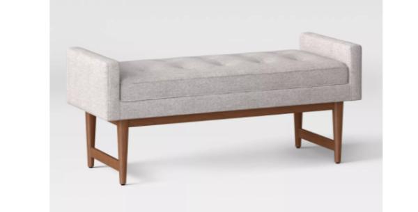 grey upholstered bench for reading nook