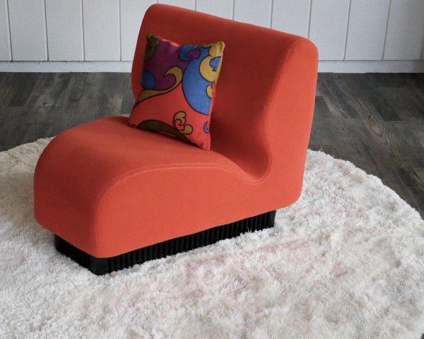 red orange wedge chair