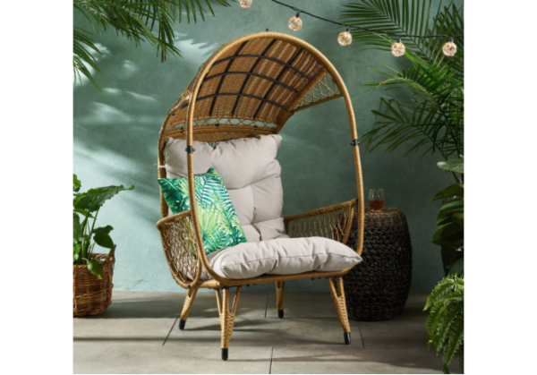 wicker chair with overhead cover and cushions